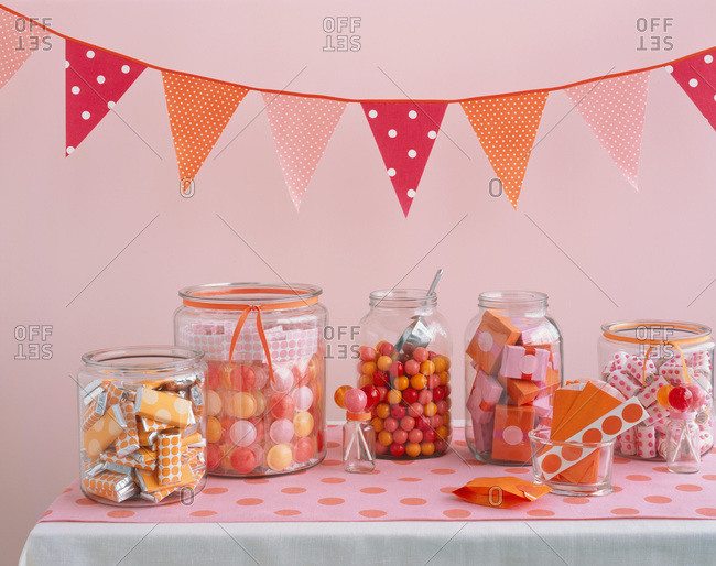 Jars stuffed with colorful confections in festive decoration