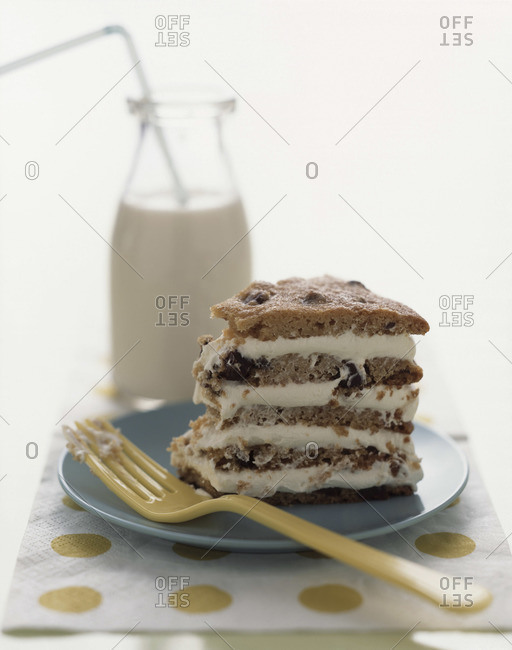 Piece of giant chocolate chip cookie cake served with milk