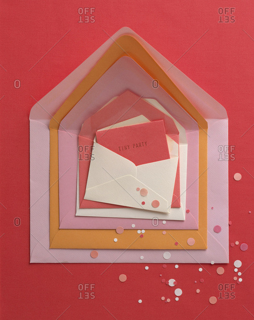 Collection of envelopes of different sizes with invitation to Tiny party
