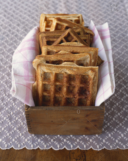 Waffles served in wooden box on the table