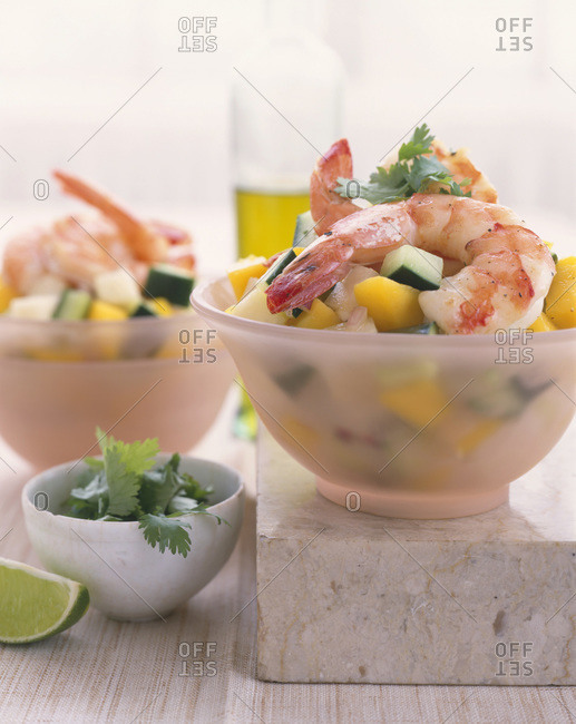 Salad with shrimps served in bowls at home