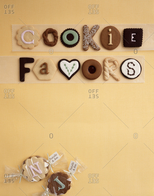 Composition with cookie favors sign written with pastry