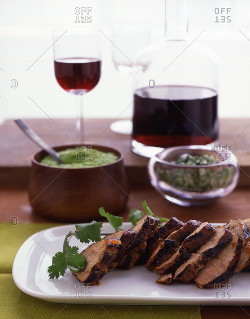 Roasted pork sliced and served on the table