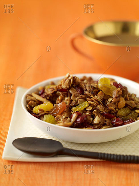 Granola in honey with raisins served for breakfast