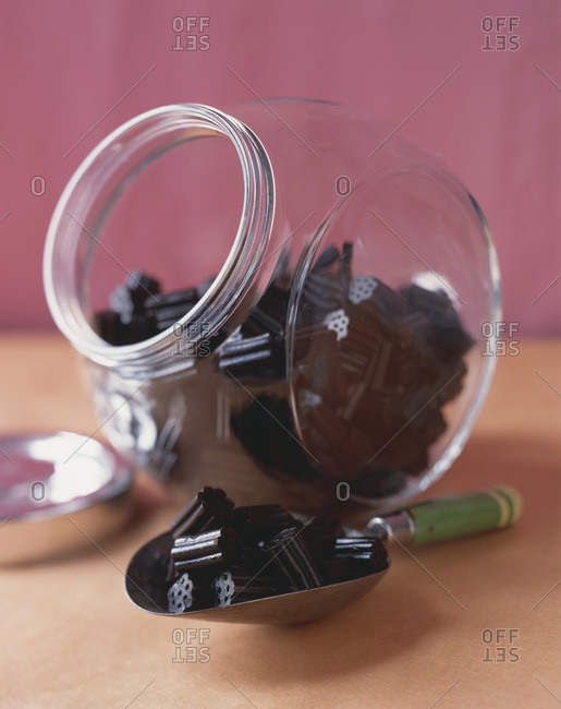 Black gummy candies served in jar and candy scoop