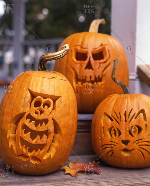 Three various designs of carving a Halloween pumpkin