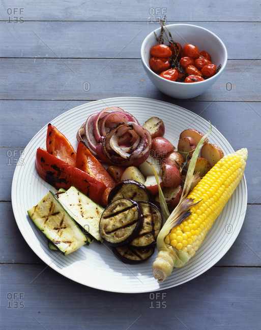 Grilled vegetables served on wooden table outdoors