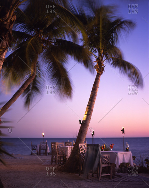 Tables spread with cocktails in exotic restaurant on seashore