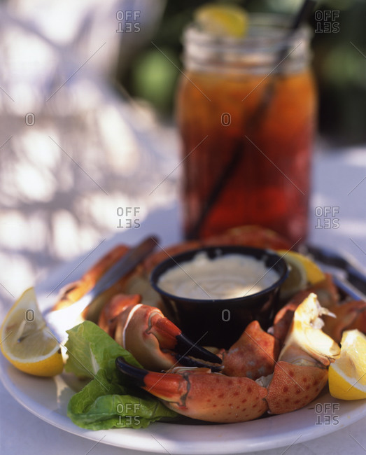 Sunny lobster served with dip outdoors