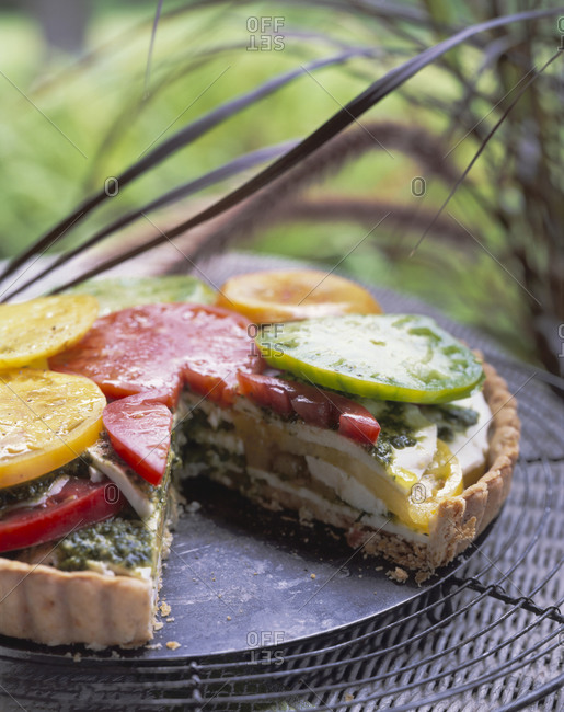 Tasteful caprese tart with rich seasoning served on the table outdoors