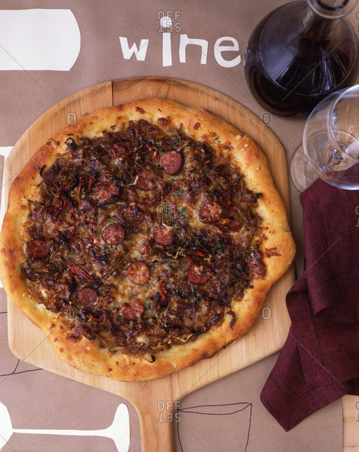 Composition with pizza served on textured surface with wine