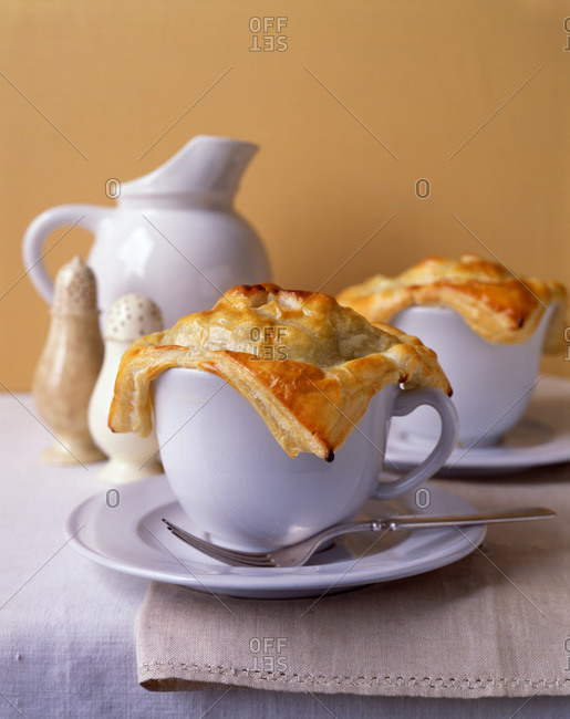 Casserole served in cup with puff pastry covering