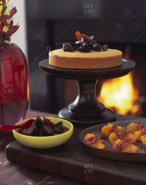 Dinner by fireplace: cake with caramelized fig topping and bacon wrapped yellow tomatoes
