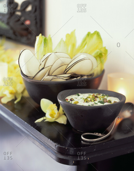 Bowls with chips and dip served for the party