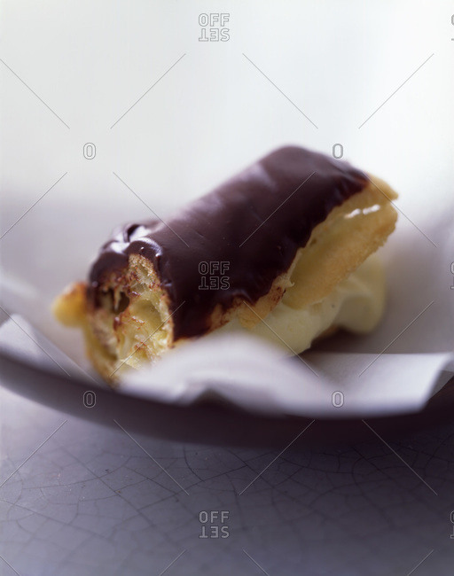 Piece of eclair pastry with a bite taken out