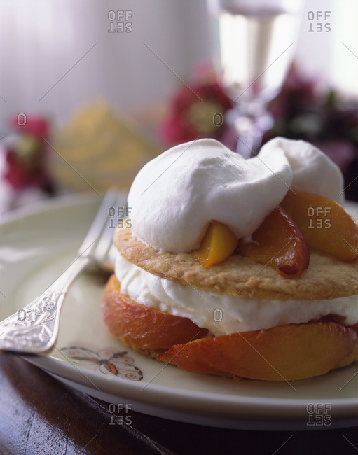 Creamy fluffy dessert with peach served with champagne
