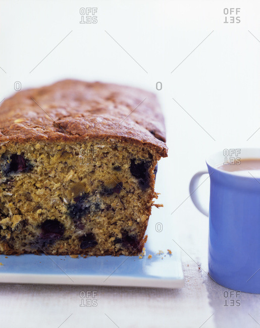 Close up tasty blueberry cake served with coffee