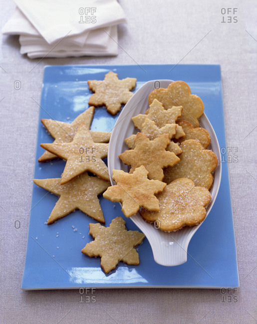 Fresh butter cookies of different forms spread on serve ware