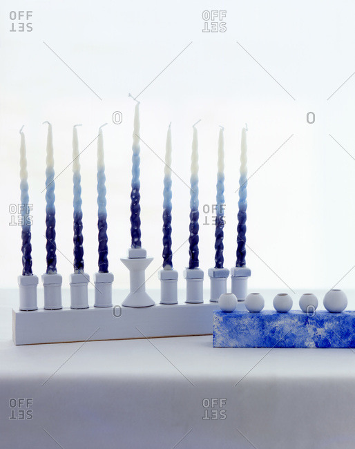 White menorah with white-and-blue candles in it