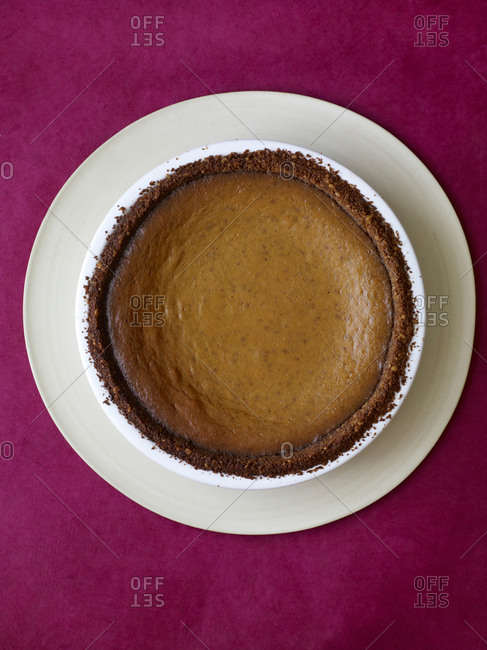 Top view of pumpkin gingersnap pie served on white plate