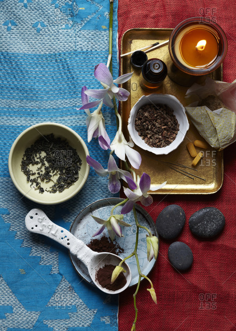 Composition with dried tea leaves, cocoa powder prepared on the table
