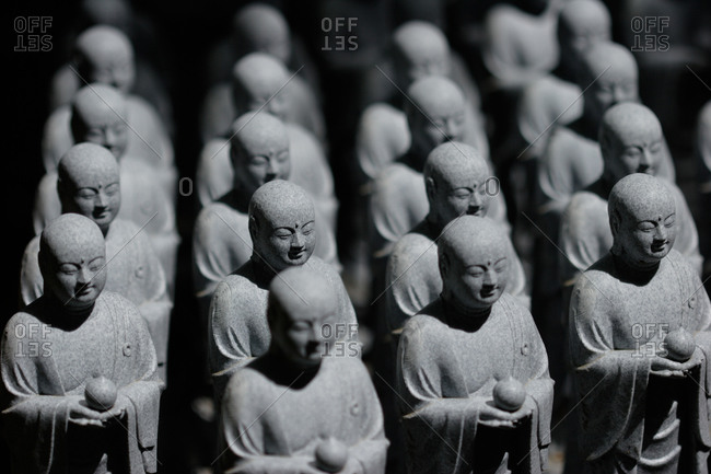 Rows of stone japanese figurines