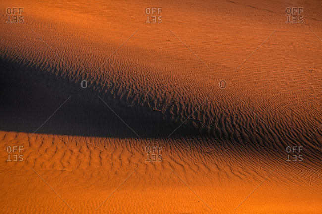 Rippled red sand dunes at twilight