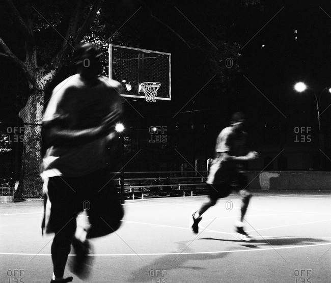 Men Playing Basketball At Night