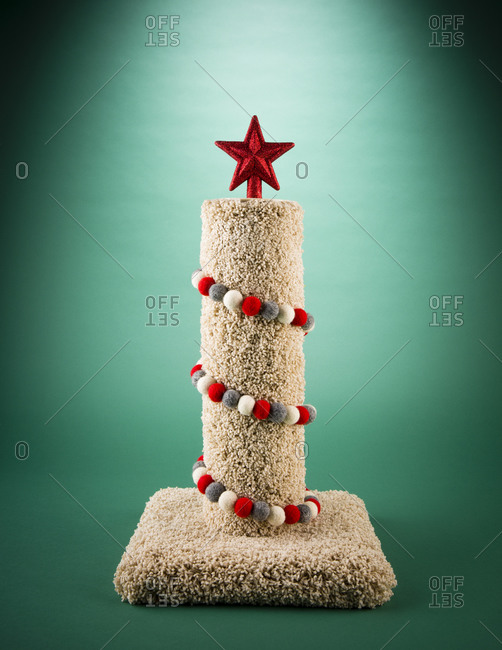Cat scratching post decorated like Christmas Tree