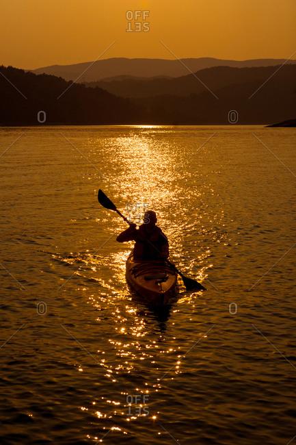 Kayaking Lake Jocassee at sunset, South Carolina, USA