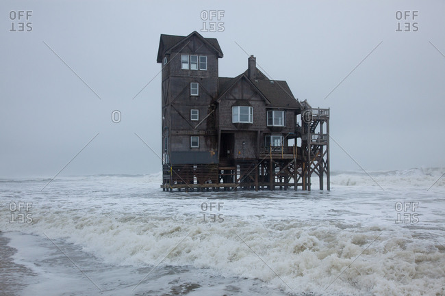"Famous old house, ""Serendipity"" being inundated by coastal flooding in Rodanthe, Outer Banks, Hatteras Island, North Carolina"