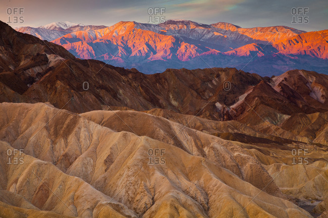 View from Zabriskie Point at sunrise looking over Death Valley and the Panamint Range, Death Valley National Park, California