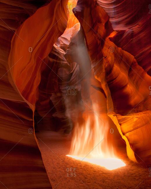 Rising dust in light beam at Upper Antelope Canyon, Arizona