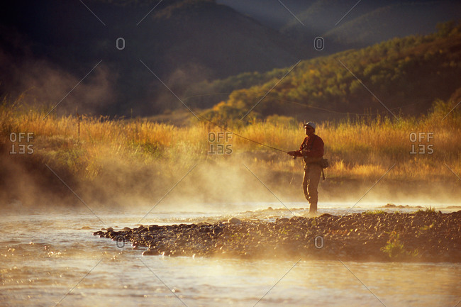 Fly fishing on a misty morning in Yampa River, Colorado