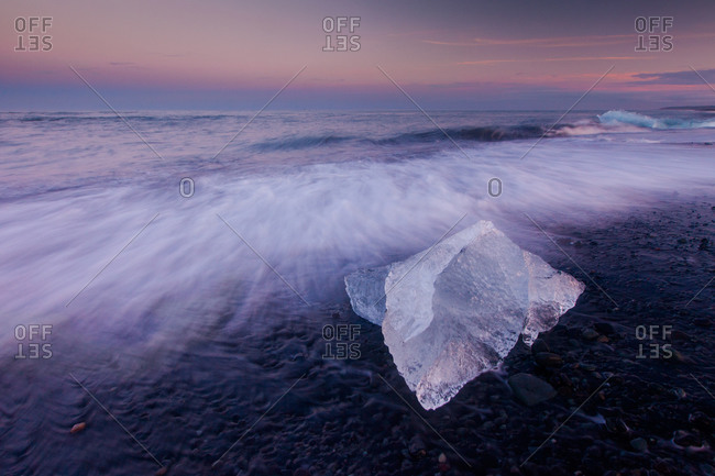 Beached iceberg on black sand near Jokulsarlon, Iceland
