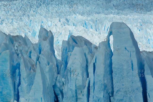 Blue light and shadow on the face of Perito Moreno Glacier in Los Glaciares National Park, Argentina