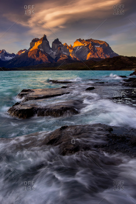 Sunset over Torres del Paine National Park with raging waves on Lago Pehoe in Patagonian Chile