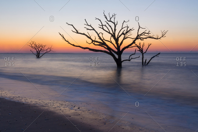 Sunrise over calm ocean at Botany Bay in South Carolina, USA