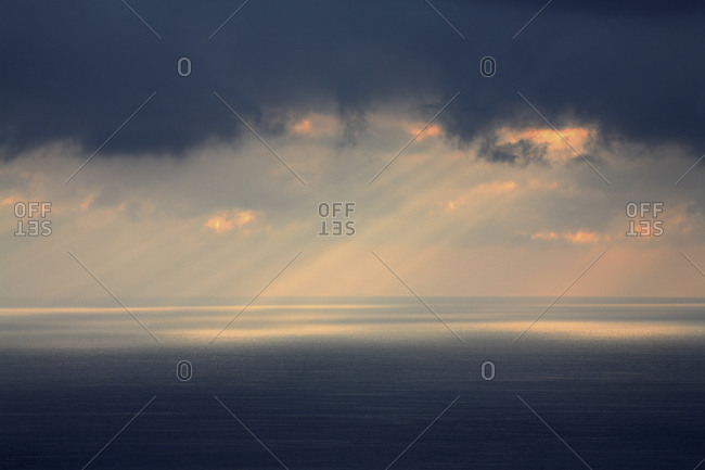 Rays Of Sun Push Through Storm Clouds Over The Pacific Ocean