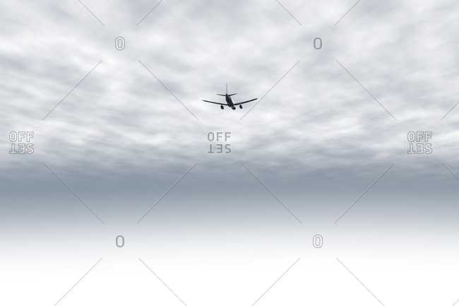 A commercial aircraft flying in the sky