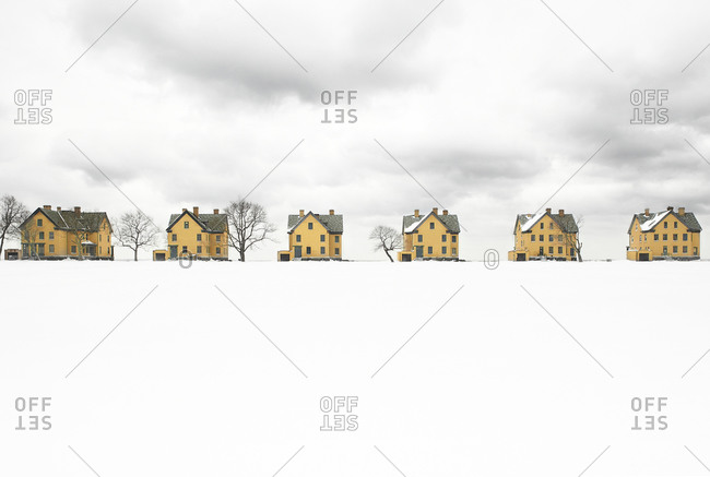 Row of houses on a snowy field