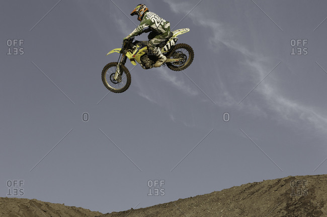 A motorcyclist performing tricks