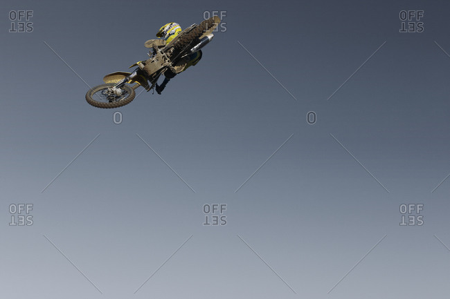 Low-angle view of a motocross rider jumping