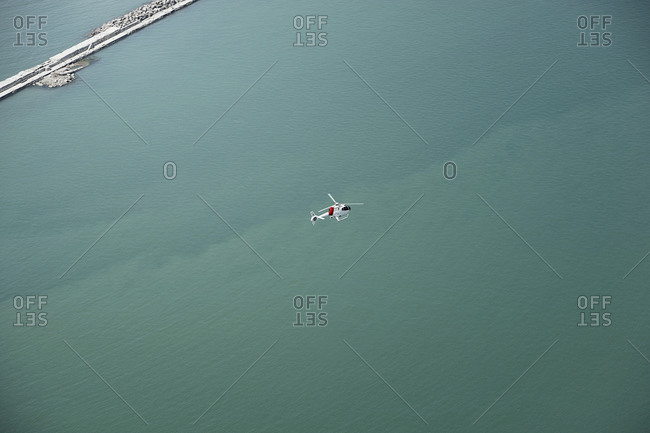 Aerial view of a helicopter and the ocean