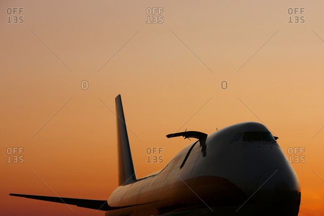 Cockpit and nose of a commercial airplane at sunset
