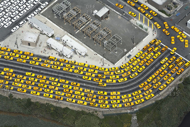 Aerial view of Rows of taxis waiting at airport