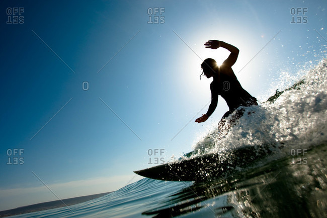 a young woman surfing a short board thruster