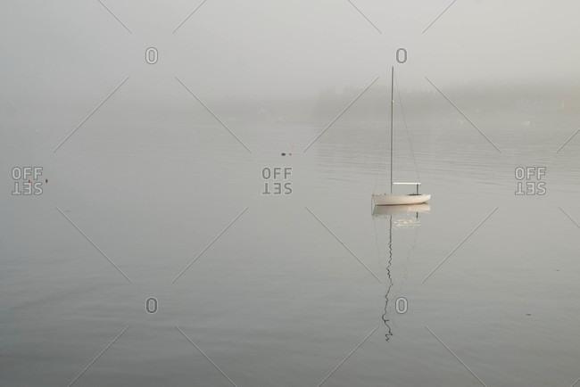 A boat is still in the morning fog