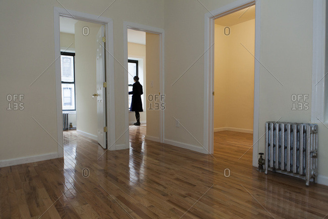 A woman inspects empty Harlem apartment