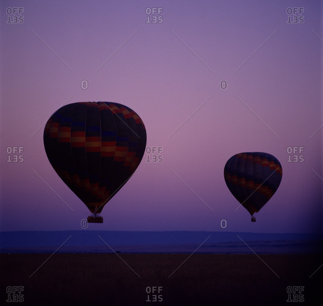 Hot Air Balloons Flying Over Plains At Dawn, Masai Mara Game Reserve, Western Kenya, Kenya
